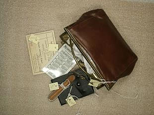 Leather purse and its contents, including a wallet-sized 1930 calendar.